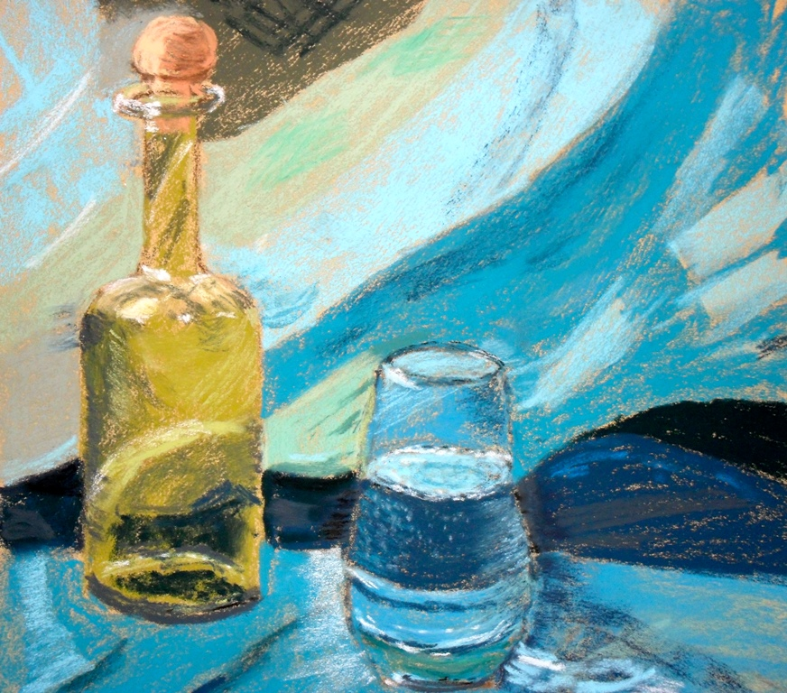 Green bottle on a turquoise cloth